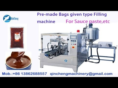 Pre made pouch packing machine.rotary pouch packing machine. bag given packing machine
